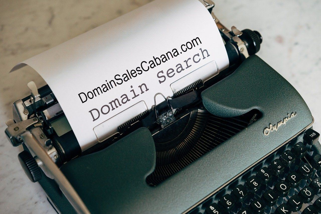 Domain Sales Cabana typewriter with page inserted.