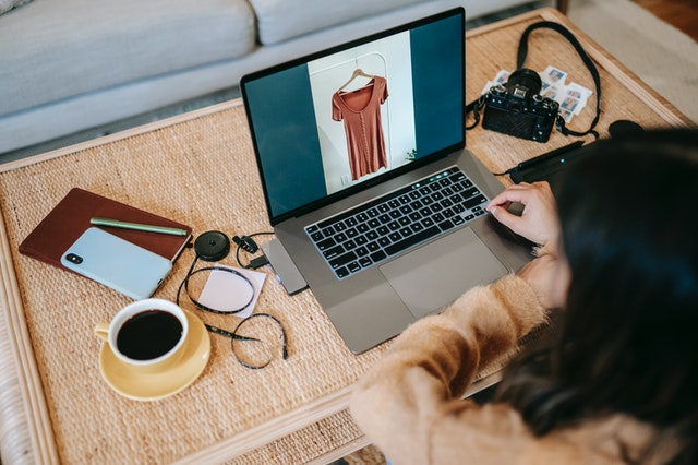 Woman shopping online for clothes representing digital self serve
