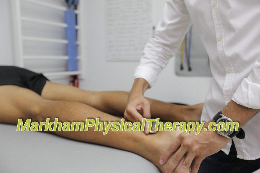 Physical Therapy practitioner assisting patient for Markham Physical Therapy.