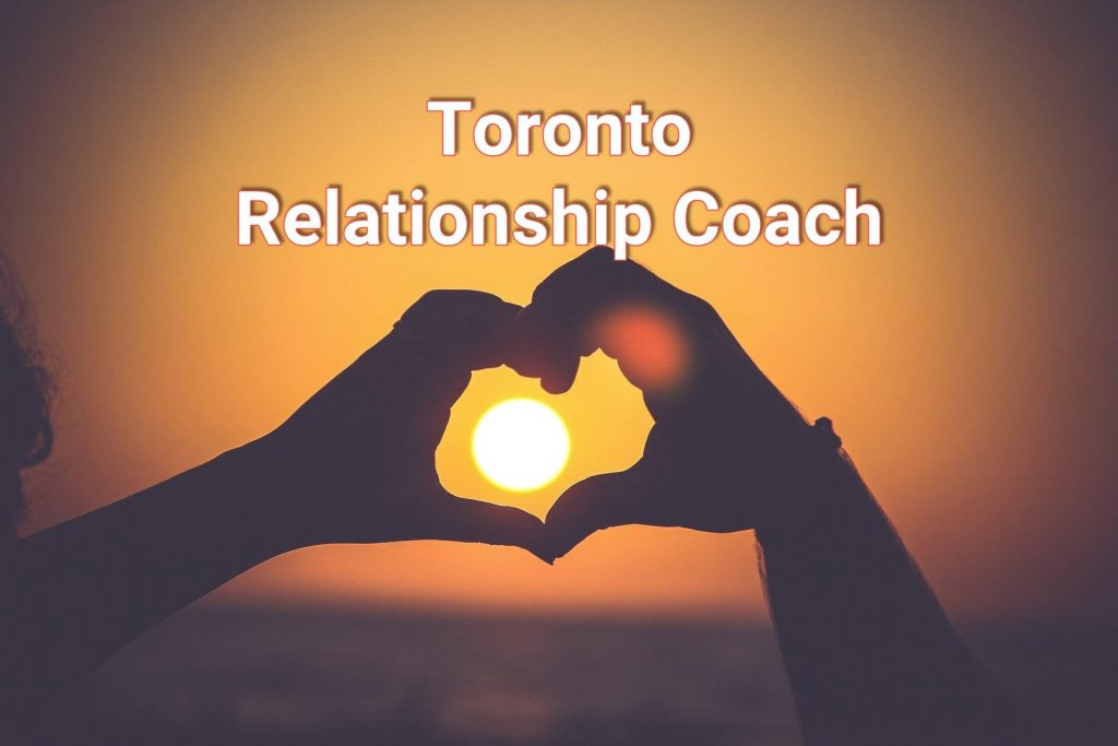 Hands shaped in a heart representing Toronto Relationship Coach.